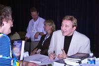 Tom Signing Books